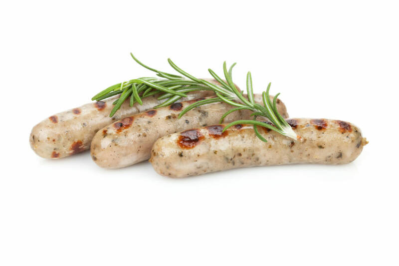 Grilled sausages with rosemary. Isolated on white background