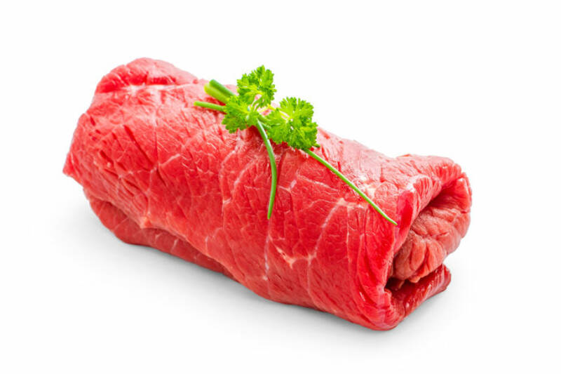 Juicy raw beef rouladen on white, close up