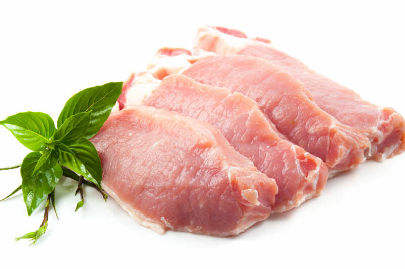 Meat, pork, slices pork loin on a white background